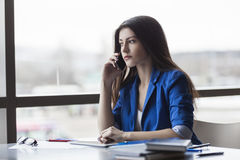 Calm businesswoman on phone in office Royalty Free Stock Images