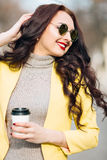 Calm casual brunette lady enjoying cup of coffee outdoor in typical italian street coffee house on warm summer day. Calm casual brunette lady enjoying cup of Stock Images