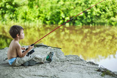 Calm child fisherman. Waiting for the catch Stock Images