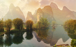 Calm Chinese River and Mountains Scene Stock Images