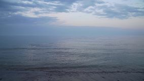 Calm clear blue sea with blue sky and white clouds peaceful and tranquil isolated ocean scene.  stock video footage