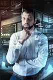 Calm clever programmer touching his beard while thinking. Looking interesting. Attentive experienced young programmer thoughtfully touching his beard and looking Stock Images