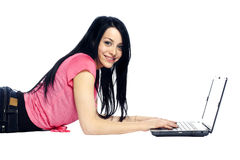 Calm and confident young woman using laptop Stock Photos