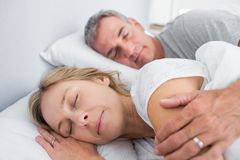 Calm couple sleeping and spooning in bed Stock Photography