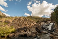 Calm creek on sunny weather. Stony creek in rural Brazil, with lush vegetation around it, on a bright sunny day stock images