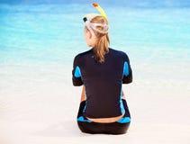 Calm diver girl on seashore royalty free stock image