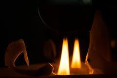 Calm, even flame of a candle. Stock Photos