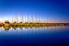Calm evening in sailing harbor Stock Photography
