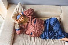 Calm fat man having nap at home Stock Photo