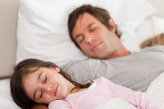 Calm father sleeping with his daughter Stock Images