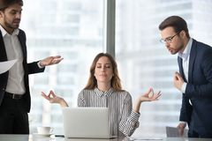 Calm female managing stress at workplace not involved in fights. Calm female worker meditate at workplace managing stress not paying attention to angry stock images