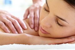 Calm female. Young woman with closed eyes enjoying massage Stock Image