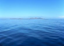 Calm Fiji Seas. Calm seas in the Mamanuca Islands group - Fiji in the far distance is Malolo Lailai Stock Photography