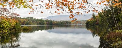 Waterbury Lake Autumn Panorama. A calm foggy Autumn morning on the Waterbury Reservoir in Waterbury, Vermont stock photos