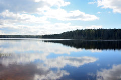 Calm forest lake with reflections Stock Photography