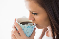 Calm girl drinking a cup of coffee Stock Photo