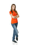 Girl in full length standing with folded hands Stock Image