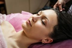 Calm girl having spa facial massage in luxurious beauty salon Royalty Free Stock Images