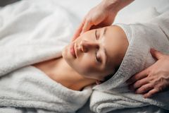 Girl having spa facial massage in luxurious beauty salon Stock Images