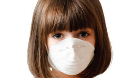 Calm girl wearing a particle mask Stock Images