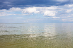 Calm green water of Azov Sea and cloudy sky Stock Photography