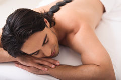 Calm guy relaxing at wellness center Royalty Free Stock Photo