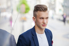 Calm handsome man on the background of summer street Royalty Free Stock Image