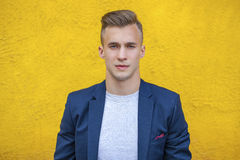 Calm handsome man on the background of summer street Royalty Free Stock Photo