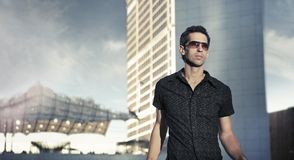 Calm and handsome man among modern architecture Royalty Free Stock Photos
