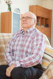 Calm handsome senior. Portrait of wistful grizzled man in interior Royalty Free Stock Image