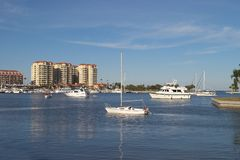 Calm Harbor. A quit tropical harbor with boats anchored and hotels in the background stock photography