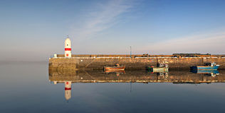 Calm Harbour, Lighthouse and Boats water reflect Stock Images