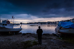 Calm Harbour Before The Storm. Calm harbor during the evening before wind, rain and thundershower located in Cinarcik town of country Turkey. Cinarcik is a small Stock Photo