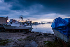 Calm Harbour Before The Storm. Calm harbor during the evening before wind, rain and thundershower located in Cinarcik town of country Turkey. Cinarcik is a small Stock Photos