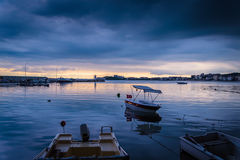 Calm Harbour Before The Storm. Calm harbor during the evening before wind, rain and thundershower located in Cinarcik town of country Turkey. Cinarcik is a small Royalty Free Stock Photo