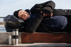 Calm homeless keeping hands crossed on the belly Royalty Free Stock Images