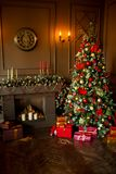 Calm image of interior Classic New Year Tree decorated in a room with fireplace. Calm image of interior Classic New Year Tree decorated in a gold room with royalty free stock photos