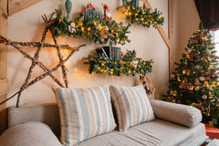 Calm image of interior modern home living room decorated christmas tree and gifts, sofa, table covered with blanket. Royalty Free Stock Photography