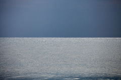 Calm Indian Ocean with Dark Blue Sky Stock Image