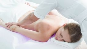 Calm lady enjoying body massage at spa