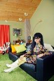 Calm Lady Sitting on Sofa Stock Image