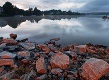A calm lake. With cloudy sky on sunrise Stock Photo