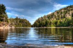 Calm lake atop a mountain. Spruce lake atop Mount Sutton, in Quebec, Canada Royalty Free Stock Photography