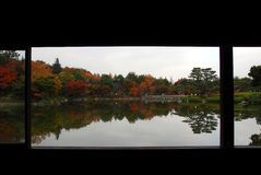 Calm lake autumn foliage frame Stock Photos