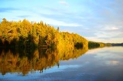 Calm lake at dusk Stock Images