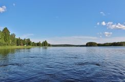 A calm lake in northern Sweden Stock Images