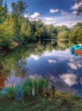 Calm lake. Peaceful lake in the forest, cottage stock image