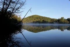 Calm Lake Reflection Stock Image