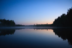 Calm lake scape at summer night Stock Photos