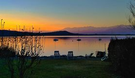 Calm on the lake shore. A relaxing sunset on the shores of Lake of Viverone Italy stock photos